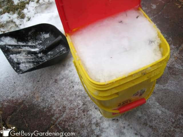 Bucket packed with snow ready for melting