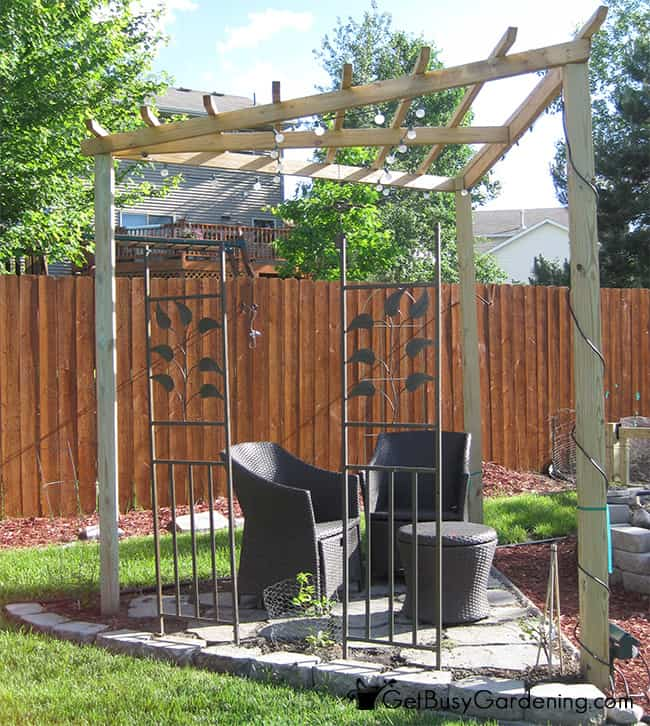 A pergola structure will create privacy for a garden sitting area