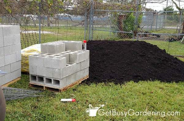 Supplies for building raised garden beds with concrete blocks