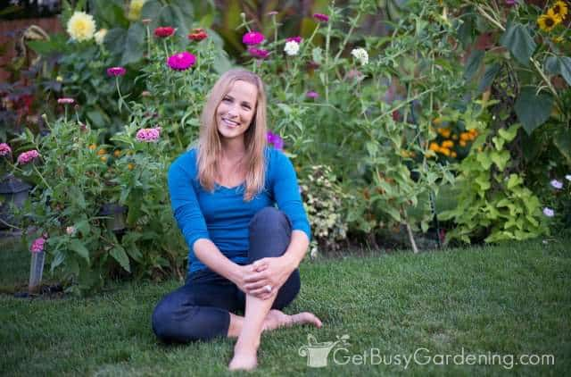 Amy Andrychowicz relaxing in front of one of her annual flower gardens in her backyard.