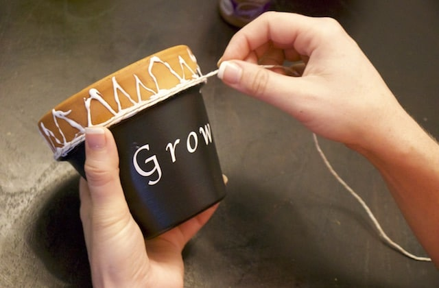 Decorating clay flower pots with twine on top
