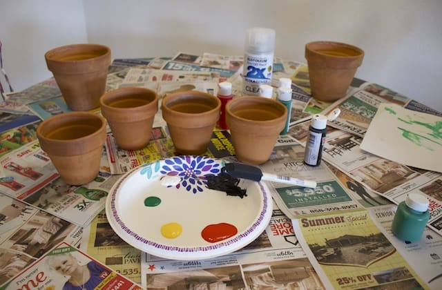 Workspace setup for painting terracotta garden pots