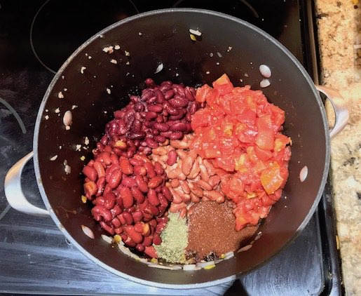 Mixing homemade chili ingredients in the pot