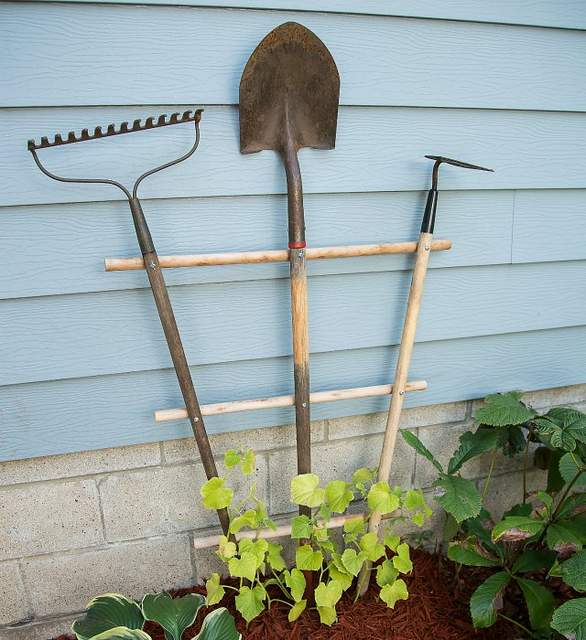 Vertical garden idea #13- Repurposed garden tool climbing trellis
