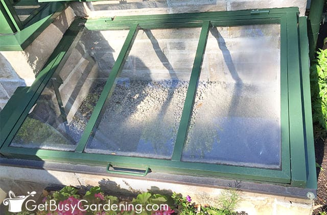 Beautiful cold frame built against a house