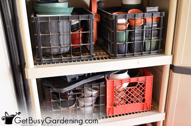 Storing garden pots in crates on a shelf